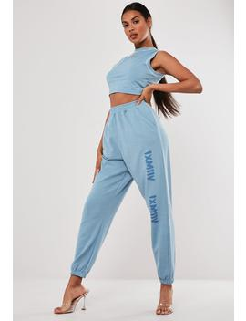 Blue Graphic Front Oversized Joggers by Missguided