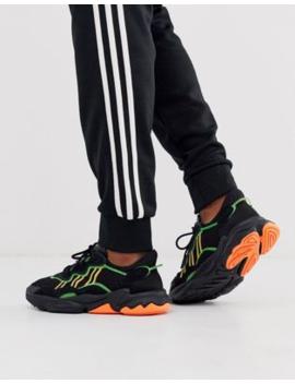 Adidas Originals – Ozweego – Schwarze Sneaker Mit Neonstreifen by Asos