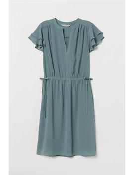 Šaty SVéčkovým Výstrihom by H&M