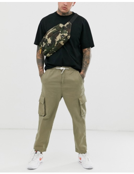 Native Youth Cargo Trousers In Khaki With Tie Hem by Native Youth