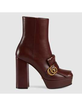 leather-platform-ankle-boot-with-fringe by gucci