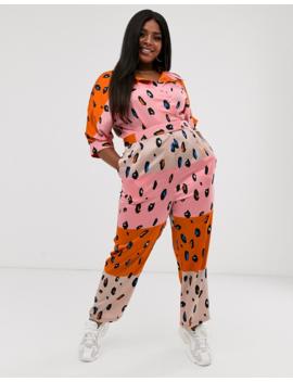 Liquorish Plus Jumpsuit With Belt In Contrasting Orange Leopard Print by Liquorish