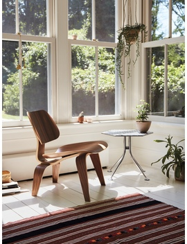 Eames Molded Plywood Lounge Chair With Wood Base by Charles And Ray Eames  Designed