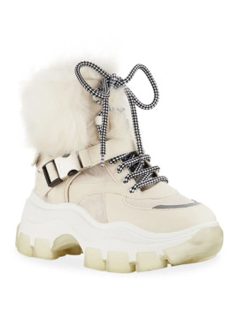 Shearling Lined Leather Lug Sole Booties by Prada