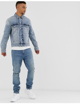 Calvin Klein Jeans Denim Trucker Jacket In Mid Wash by Calvin Klein