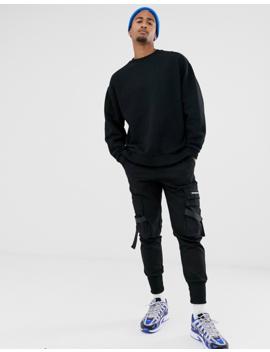 Asos Design – Schwarzes Oversize Sweatshirt Mit Schlitz Am Saum by Asos