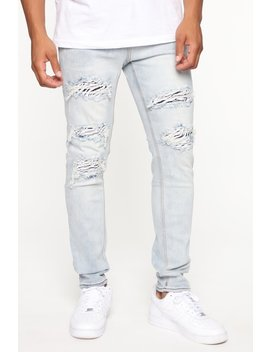 Distressed Zebra Rip And Repair Skinny Jean   Light Wash by Fashion Nova