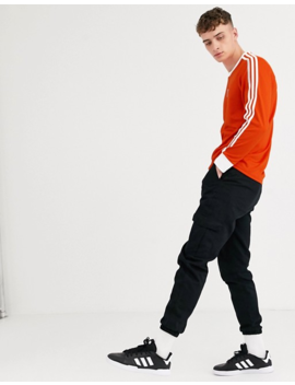 Adidas Skateboarding   Top Manches Longues à 3 Bandes   Orange by Adidas