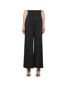 Black Thick Bottom Trousers by Pleats Please Issey Miyake