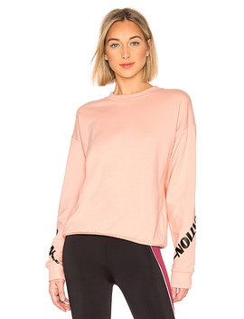 The Half Run Sweatshirt In Light Salmon by P.E Nation