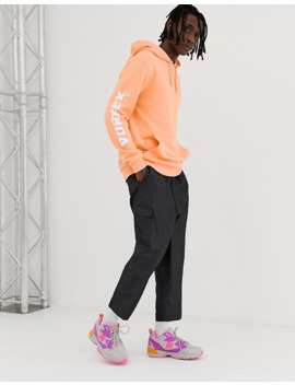 asos-design-hoodie-with-arm-print-in-light-orange by asos-design