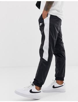 nike-contrast-stripe-cuffed-joggers-in-black by nike