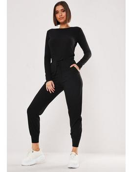 black-rib-long-sleeve-tie-waist-jogger-jumpsuit by missguided