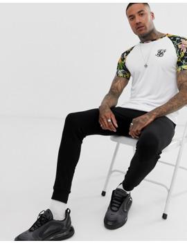 camiseta-blanca-con-mangas-florales-en-contraste-de-siksilk by siksilk