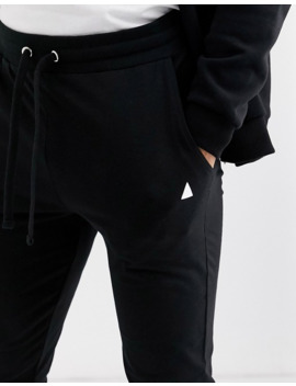 asos-design-lightweight-super-skinny-joggers-in-black-with-triangle by asos-design