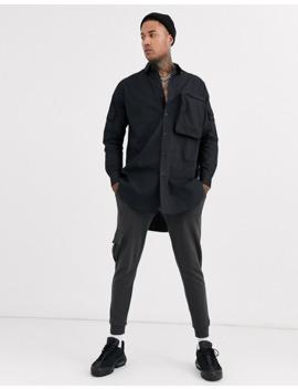 asos-design-regular-fit-super-longline-poplin-shirt-with-3d-zip-pocket-in-black by asos-design