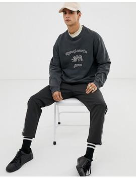tiger-of-sweden-jeans-–-svart-sweatshirt-med-rund-halsringning-och-folielogga by tiger-of-sweden