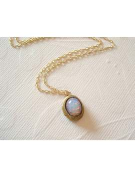 opal-necklace-tiny-brass-locket-harlequin-fire-opal-jewelry by etsy
