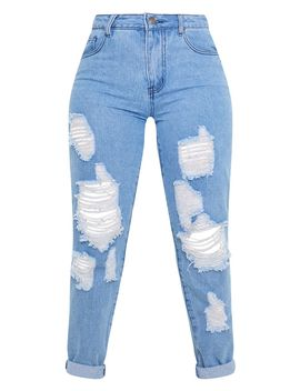 petite-mid-wash-distressed-jean- by prettylittlething