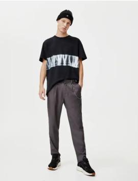 pantaloni-chino-tailored-fit-con-catena by pull-&-bear