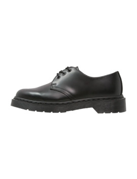 Lace Ups by Dr. Martens