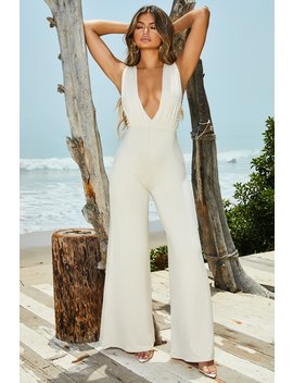 Wanderlust Petite Plunging Wide Leg Jumpsuit In Cream by Oh Polly