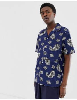 lacoste-l!ve-short-sleeve-revere-collar-printed-shirt-in-navy by lacoste-live!