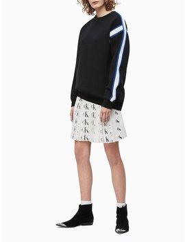 Monogram Logo Plissé Skirt by Calvin Klein