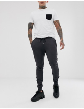 asos-design-skinny-sweatpants-in-washed-black-with-silver-zip-cuffs by asos-design