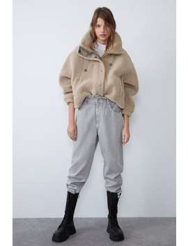 faux-shearling-jacket-with-contrast-trims by zara