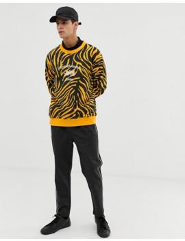 tiger-of-sweden-jeans-–-gelbes-sweatshirt-mit-tigerfellmuster by asos