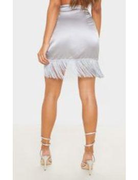 silver-satin-fringe-mini-skirt- by prettylittlething