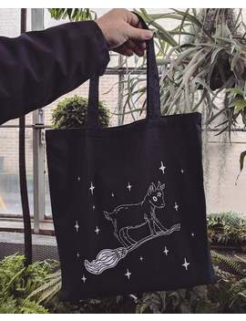 tote-bag---learning-to-ride---witchy-sabbatical-baby-goat-on-broomstick by etsy