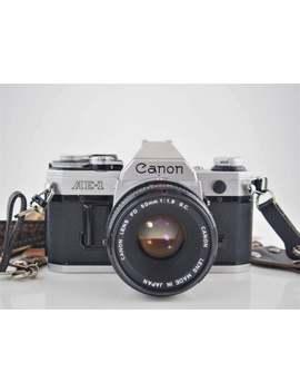 canon-ae-1-manual-slr-film-camera-+-50mm-f18-prime-lens-+-neck-strap by etsy