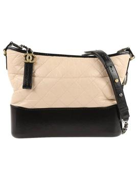 gabrielle-excellent-quilted-aged-calfskin-medium-beige-_-black-leather-hobo-bag by chanel