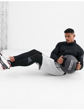 adidas-performance-1_4-zip-sweatshirt-in-black by adidas