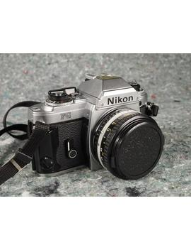 nikon-fg-35mm-slr-film-camera-with-50mm-prime-lens,-tested,-new-seals by etsy