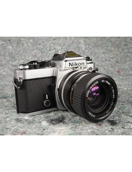 nikon-fe-35mm-slr-film-camera-with-35-70mm-zoom-lens,-tested,-new-seals by etsy