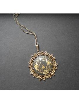 damascene-black-and-gold-enamel-pendant-with-bird-and-flowers,-filigree-design by etsy