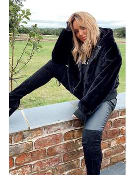 Charlotte Crosby Black Faux Fur Hooded Bomber Jacket by In The Style