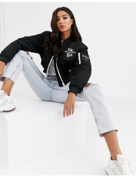 Calvin Klein Jeans 50th Anniversary Logo Cropped Bomber Jacket by Calvin Klein Jeans