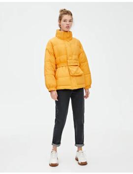 Оранжевая стеганая куртка с поясом by Pull & Bear