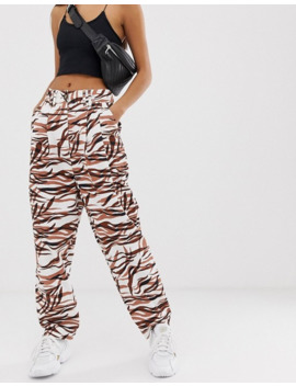 Asos Design Ovoid Pleat Front Peg Trouser In Tiger Print by Asos Design