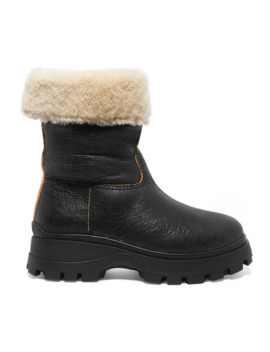 Shearling Lined Cracked Leather Ankle Boots by Miu Miu