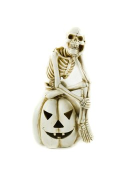 """11"""" Ivory Skeleton Sitting On Pumpkin Lighted Halloween Decor by The Costume Center"""
