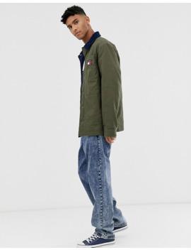 Tommy Jeans – Workwear – Jacke Mit Kontrastierendem Kragen Aus Cord Und Flaggenlogo In Grün by Asos