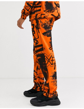Jaded London Sweatpants In Orange Graffiti Print by Jaded London