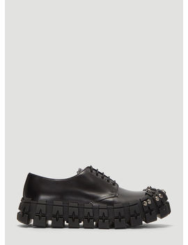 Studded Brushed Leather Shoes In Black by Prada