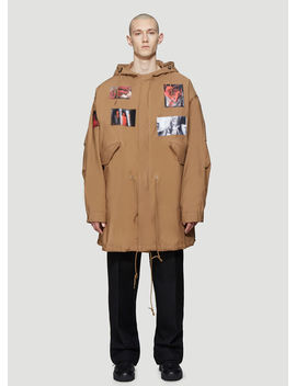Mid Length Patch Parka Coat In Brown by Raf Simons