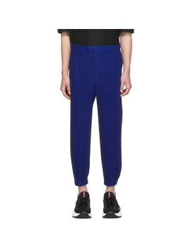 Blue Tapered Pleat Trousers by Homme PlissÉ Issey Miyake